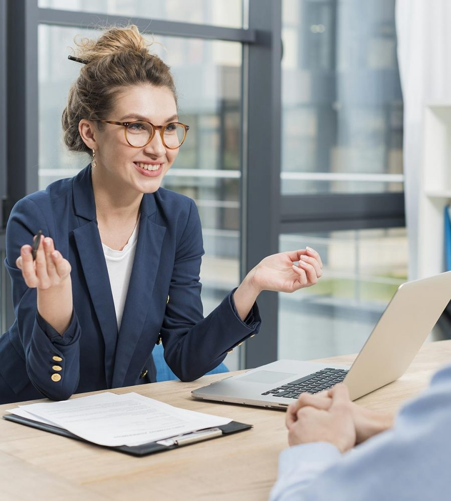side-view-woman-holding-job-interview-with-man